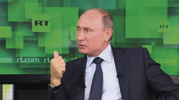 Russian Federation President Vladimir Putin interviewed on RT in June 2013 (Credit: RT)