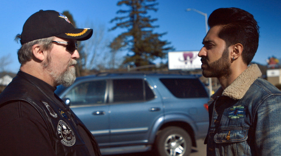 Mobeen Azhar with a member of a far-right group in Oregon (Credit: BBC/Expectation Entertainment Ltd)