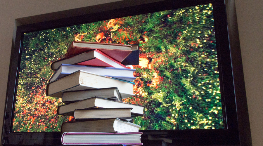 books in front of tv image