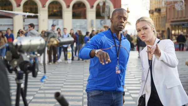 Adrian Lester with Julia Stiles on the set of Riviera (Credit: Sky)
