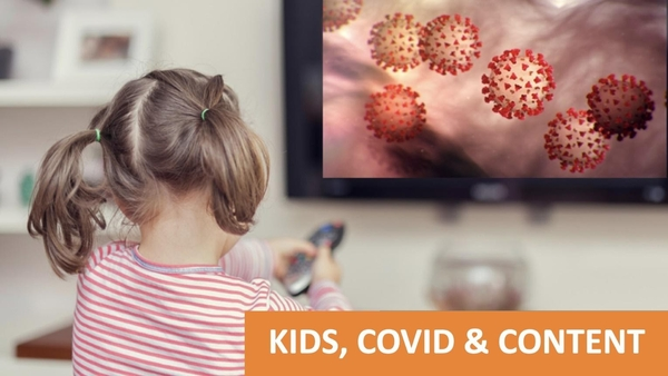 A young girl holding a TV remote while watching children's programming