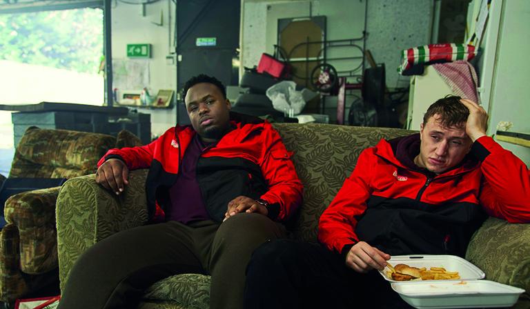 Joshua (Samson Kayo) and Ricky (Theo Barklem-Biggs) in Sliced (Credit: UKTV)